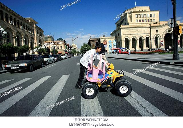 Pedestrians at the Republic Square in Yerevan. Armenia