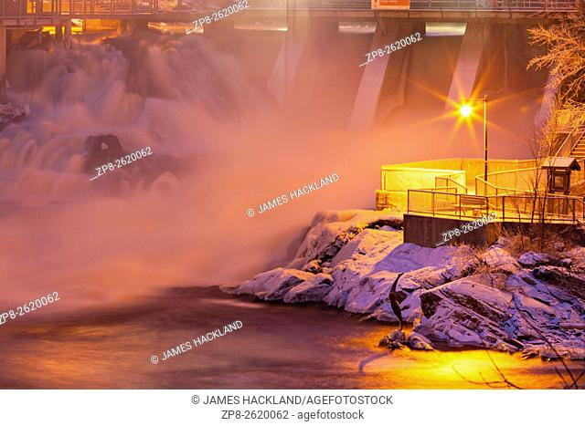 Lower Bracebridge Falls and hydro dam with a fresh snowfall on the Muskoka River. Bracebridge, Muskoka, Ontario, Canada