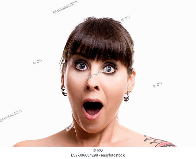 Close-up portrait of a lovely woman with a astonish expression against white background