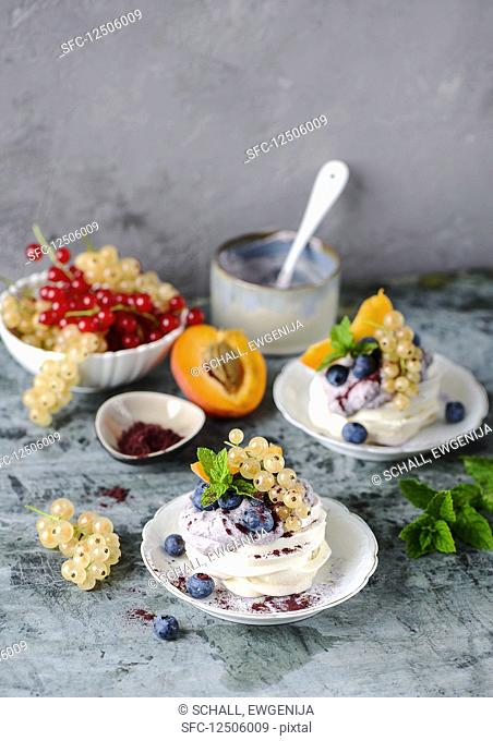 Mini pavlovas with whipped cream and fruit