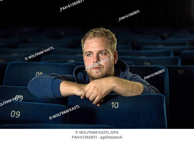 The young director Dustin Loose sits in a cinema chair in Ludwigsburg, Germany, 17 August 2015. He is one of three young director's who will be honored with a...