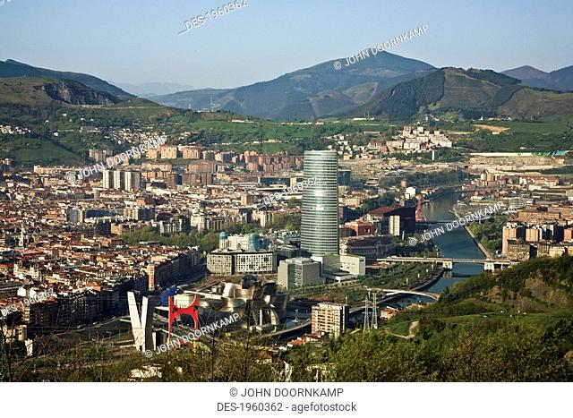 buildings in the valley and view of the guggenheim museum, bilboa, spain