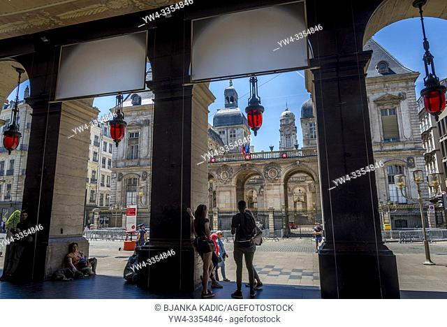 Monumental City Hall at the Place des Terreaux seen through the arches of the Opera house, Lyon, France