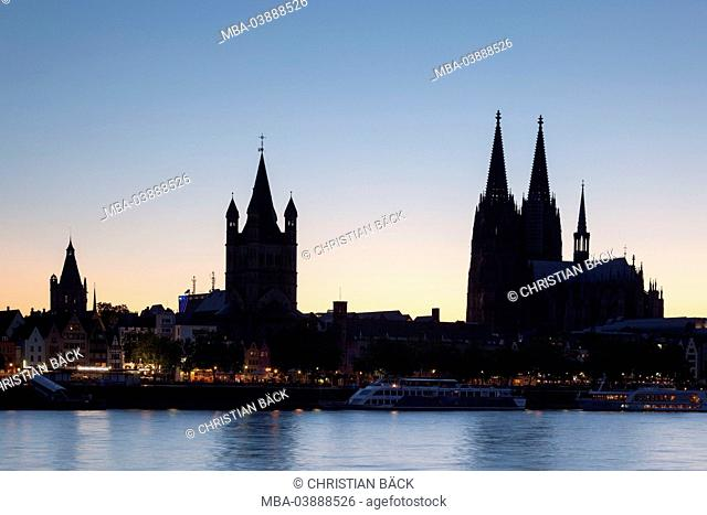 Silhouette Cologne Cathedral and Church Groß St. Martin at the Rhine River, Cologne, North Rhine-Westphalia, Germany