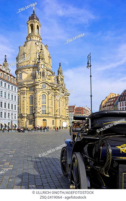 Dresden, Saxony, Germany - An e-vehicle in front of the Frauenkirche Church on the Neumarkt Square, which looks like an oldsmobile coach