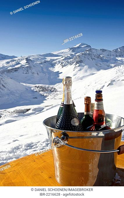 Champagne bottle in a bar, snow-covered mountain landscape, Tignes, Val d'Isere, Savoie, Alps, France, Europe