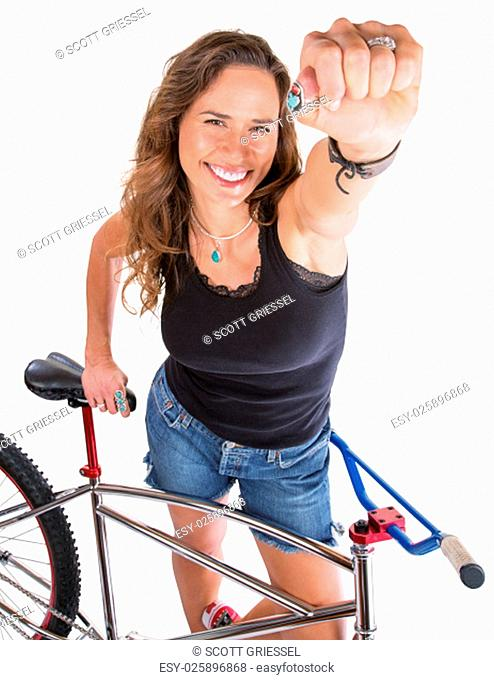 Isolated beautiful mountain biker showing her fist
