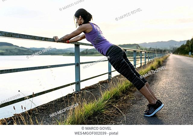 Woman warming up for outdoor training