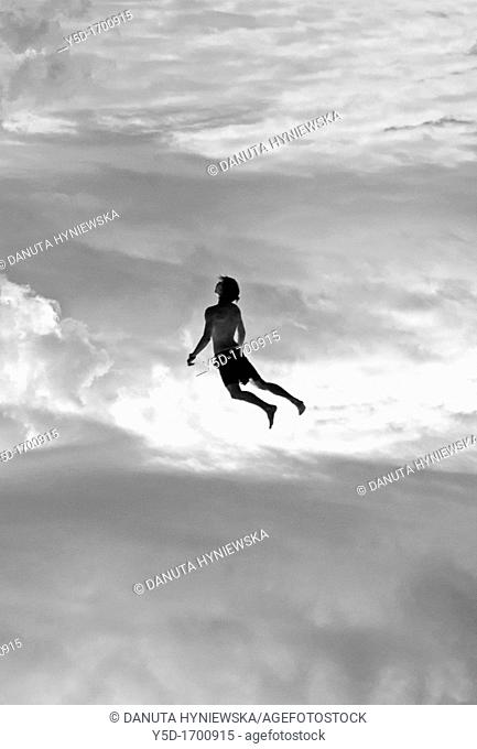 human flying in the sky, freedom, flying up to our dreams, Peter Pan