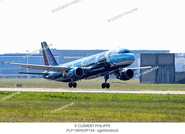 Airbus A320-214 in Magritte livery, commercial passenger twin-engine jet airliner from Belgian Brussels Airlines taking off from Brussels Airport