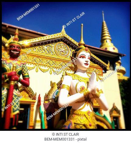 Statues outside Golden Buddha statue in Wat Chayamangkalaram temple, Penang, Malaysia