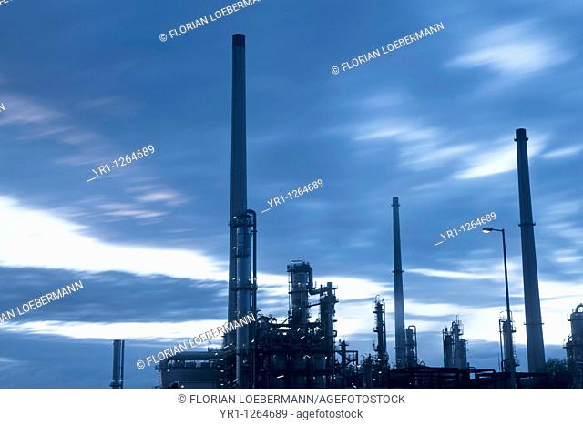 An oil refinery in southern germany. Long exposure for dramatic sky, shot shortly after sunset blue hour