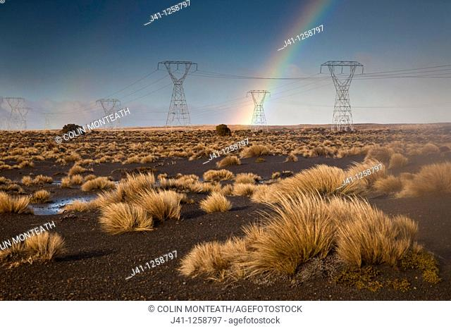 Rainbow over power plyons, Rangipo desert near Mt Ruapehu, Tongariro National Park