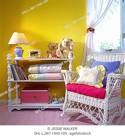 CHILDREN'S BEDROOM: Baby room. White changing table on the left and white wicker rocker on the right. Bright and bold yellow painted walls