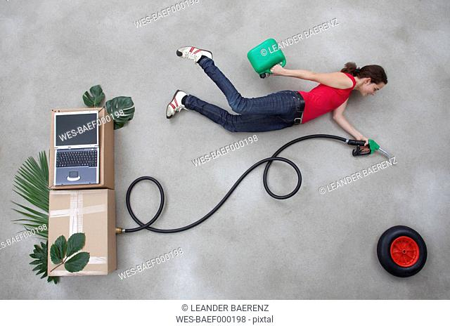 Mid adult woman holding industrial hose