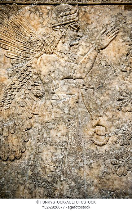 Assyrian relief sculpture panel of a female protective spirit from Nimrud, Iraq. 865-860 B. C North West Palace, Room I. British Museum Assyrian Archaeological...