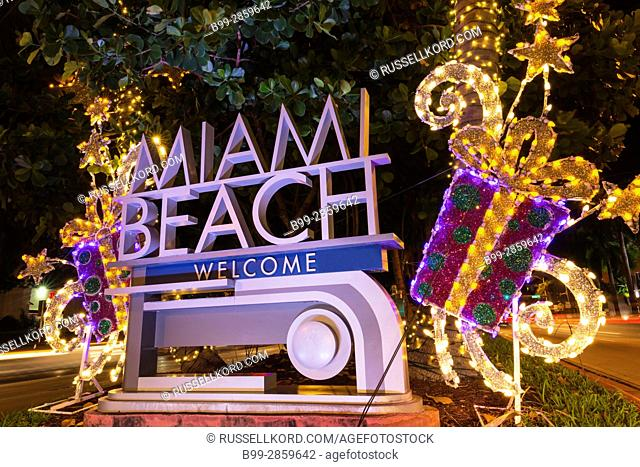 christmas decorations on welcome sign miami beach florida usa