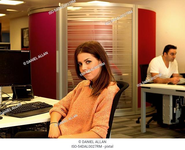 Businesswoman smiling at desk