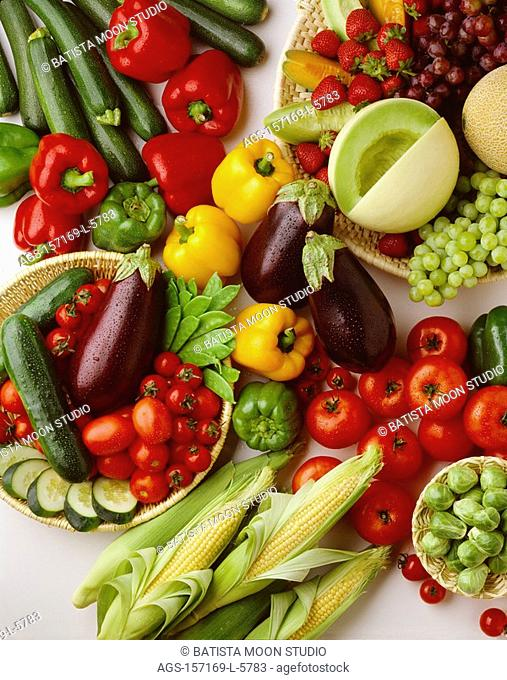 Agriculture - Arrangement of fruits and vegetables on white: strawberries, red & green grapes, honeydew melon, cantaloupe, tomatoes, eggplant, brussels sprouts