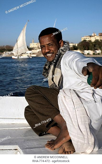 Man sailing felucca on the river Nile at Aswan, Egypt, North Africa, Africa