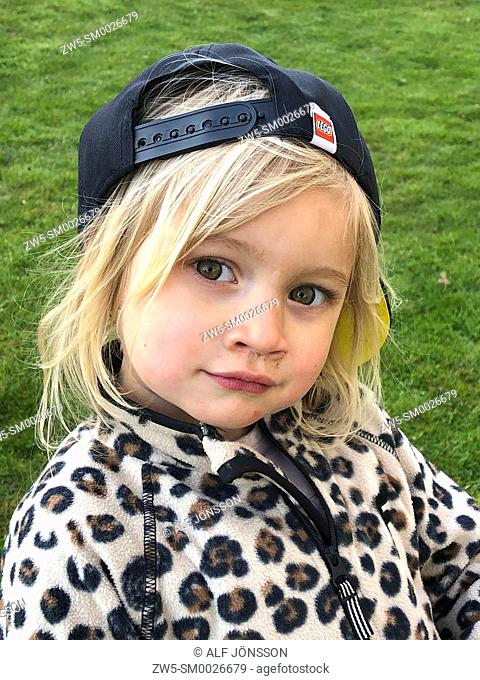 Portrait on a blond three years old girl
