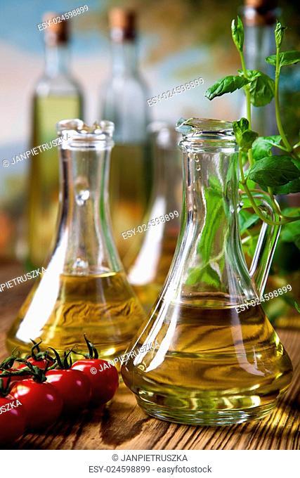 Olive oils in bottles, Mediterranean rural theme