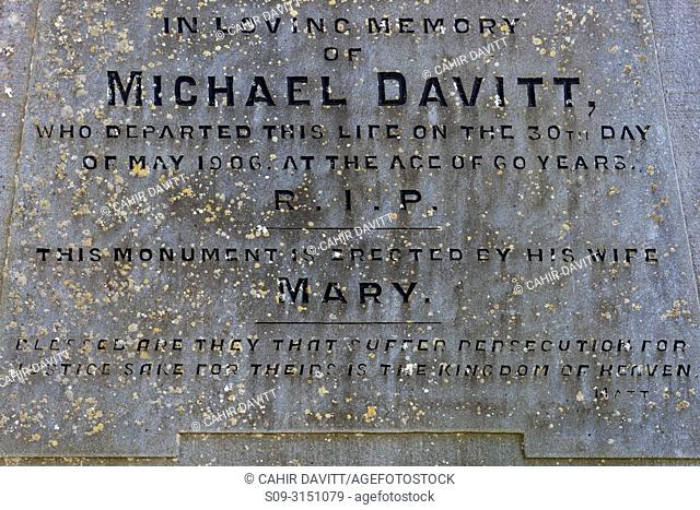 Headstone engraving of the grave of Michael Davitt (Founder of the Irish National Land League) located in the cemetery of Straide Abbey, Straide, Co