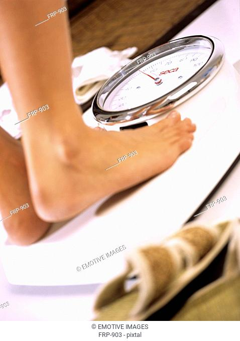 Woman standing on the scales