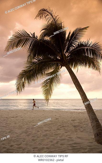 Caribbean, Jamaica, Negril,Man running on sandy shore