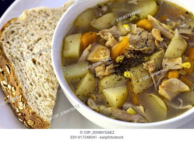 Simple home made chicken soup with bread
