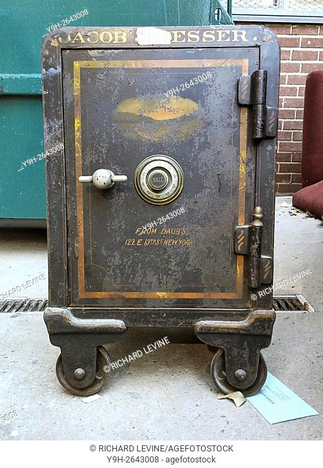 A safe is seen in the trash area of an apartment building in New York