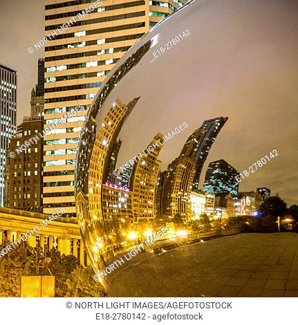 USA, IL, Chicago. Night view of famous public art sculpture, Cloud Gate, by Indian-born, British artist, Anish Kapoor. It is also known as The Bean