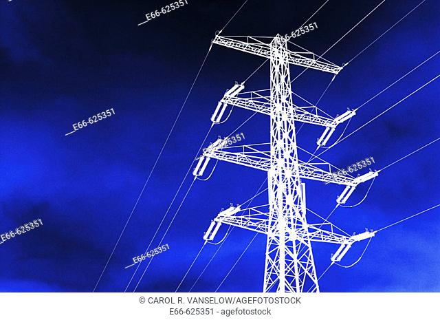high tension electrical wires and pylon. reversed image with dramatic blue sky
