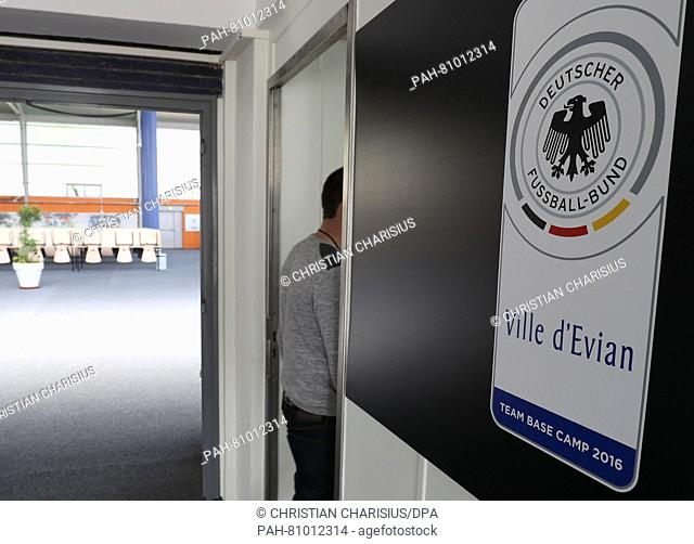 """A man enters the press room at """"""""Team Base Camp Germany» in Évian-les-Bains, France, 07 June 2016. The UEFA EURO 2016 takes place from 10 June to 10 July 2016..."""