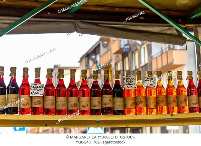 Selection of home made raspberry syrups at the farmers market in Krakow, Poland