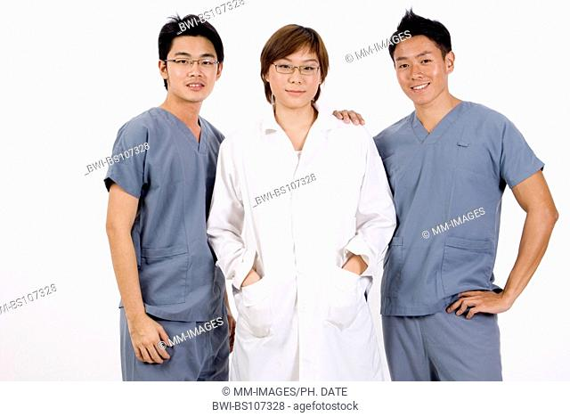 group of three Asian medical professionals, one woman and two men