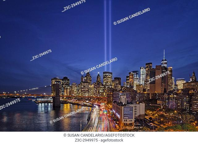 911 Tribute In Light In NYC - View to the Brooklyn Bridge, the FDR highway and the Financial District during the Tribute In Light memorial