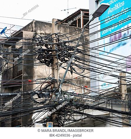 Power lines on utility pole, Bangkok, Thailand