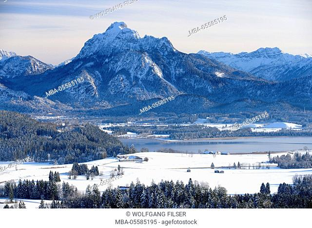 Panorama winter scenery in the Allgäu, Bavaria, close view at the mountains of the alps and the Hopfensee at Füssen