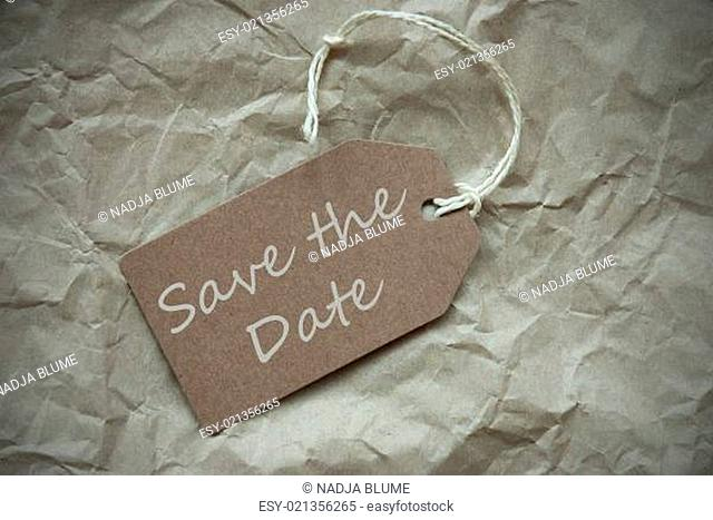 One Beige Label Or Tag With White Ribbon On Crumpled Paper Background With English Text Save The Date Vintage Or Retro Style With Frame