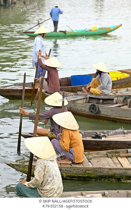Women on the river at the water market in Hoi An