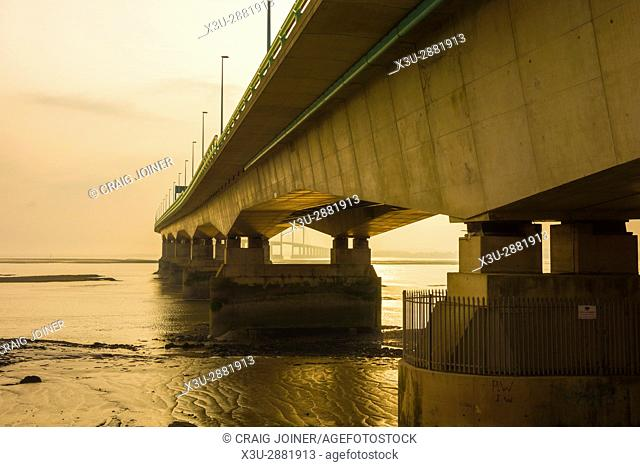 The Prince of Wales Bridge (Second Severn Crossing) during a hazy sunset over the Severn Estuary viewed from Severn Beach, Gloucestershire, England