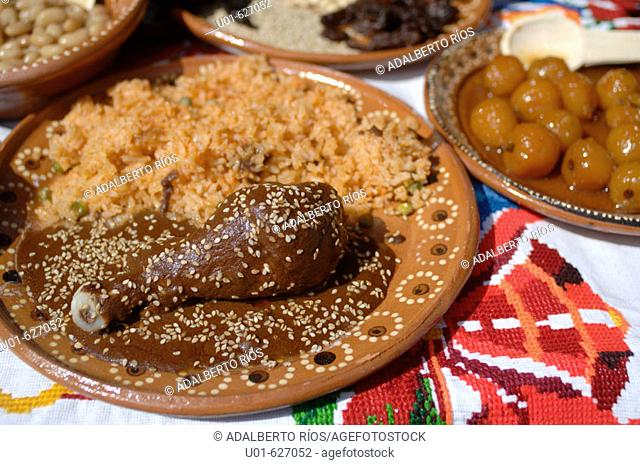 Chicken Mole with rice./ Plato de mole con arroz. El mole es una manera de preparar carnes de ave,  res y puerco en salsas de multiples componentes que mezclan...