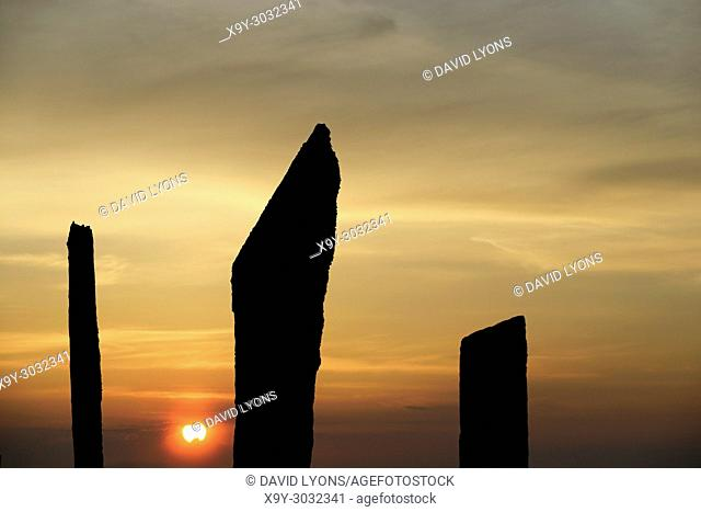 Standing Stones of Stenness, Orkney. 5m high prehistoric megaliths stone circle henge monument. originally of up to 12 stones over 5000 years. Sunset