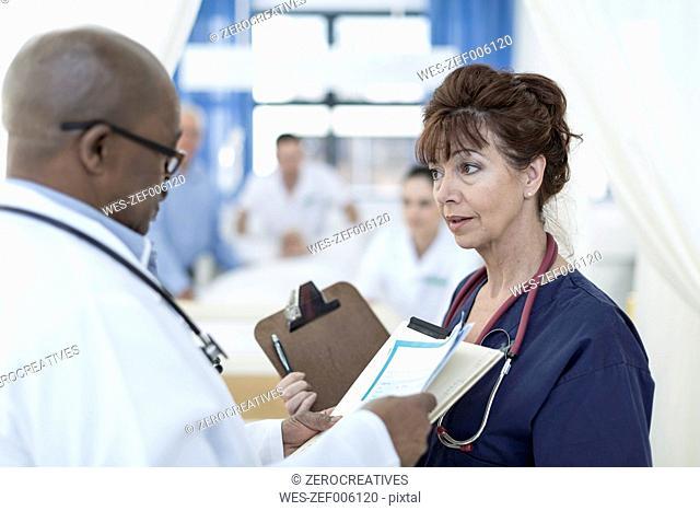 Two doctors in hospital talking