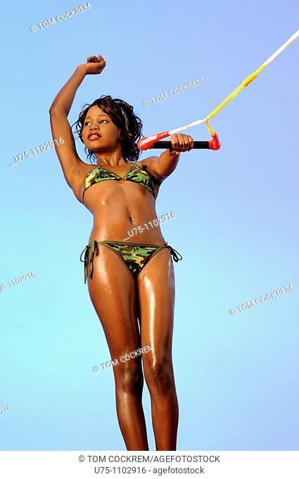 black african girl in water ski pose