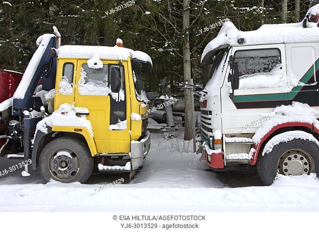 two snowy trucks, Finland