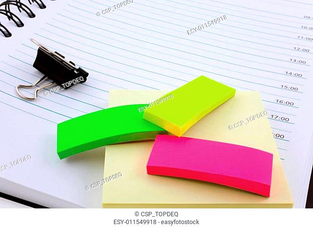 personal organizer, post-its and steel clip