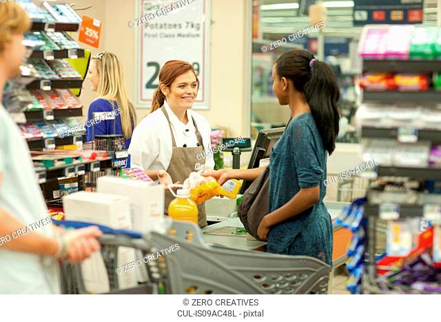 Female shop assistant at check-out