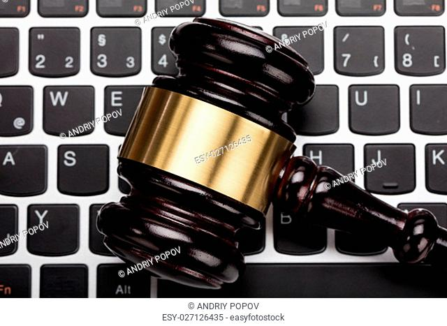Close-up Of A Wooden Judge Gavel On Laptop Keyboard
